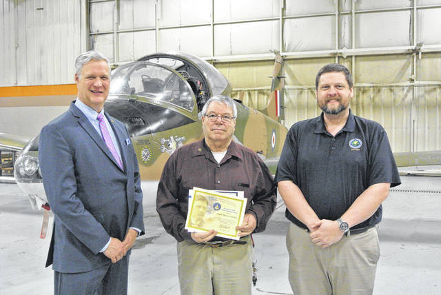 Gene Kropfelder (middle) was recently honored with the Charles Taylor Master Mechanic Award. He is pictured with Great Oaks President/CEO Harry Snyder (left) and Jason Forshey.