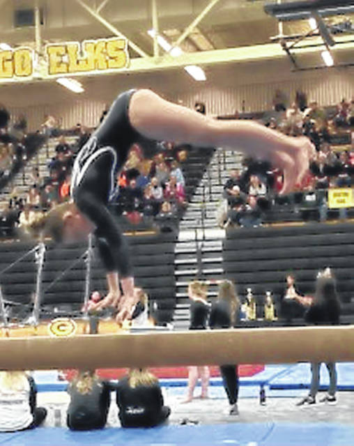 Devan Thomas performs her flight skill on balance beam, round-off.