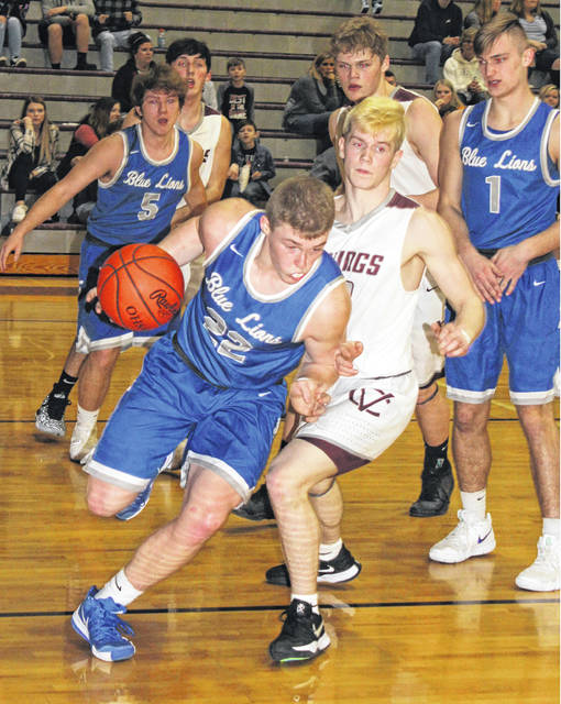 Washington junior Drew Moats drives with the ball out from under the basket during a non-conference game at Vinton County High School Saturday, Feb. 2, 2019. Also pictured for Washington (l-r); Miguel O'Flaherty (5) and Eli Lynch (1) (both juniors).
