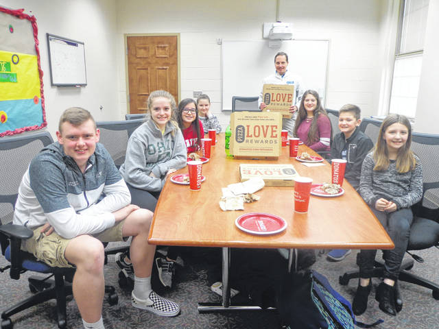 """Donatos recently provided pizza to these students at Washington Middle School as they celebrated """"Pizza with the Principals."""" This is in appreciation for their selection as Students of the Month for February. They are chosen by their teachers because of the outstanding example they set for their peers in such areas as academic effort, good work ethic, kindness to others, and service to their school. Pictured from left: Tanner Lemaster, Addison Chambers, Kylee Jones, Madison Picklesimer, (Principal, Mr. Wayne) Trinity Smith, Evan Lynch and Molly Preston. Absent: Kylan Walker."""