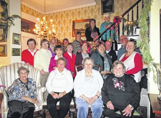 Fayette County Genealogical Society members and guests attending the holiday dinner were seated: Sue Maddux, Mary Stolsenberg, Phyllis Rankin, Sue Gilmore. Standing were: Lauran Perrill, Janet Robinson, Glen Rankin, Sue Raypole, Linda Gossett, Patti Hagler, Jill Roberts, Chuck Gossett, Steve Owens, Myckki Harkleroad. On the stairs were: Tracey Owens, Pam Rhoads, Sandy Kelly, Peggy Lester.