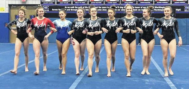 The team presents to the judges before the floor exercise competition. Alexis Gardner (Miami Trace), Lizzy Valentine (Greeneview), Sydney Shadburn (Washington) and from Miami Trace, Kandice Mathews, Maddy Southward, Milana Macioce, Ali Cusic, Alyssa Butler and Devan Thomas.