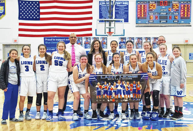 2018-19 FRONTIER ATHLETIC CONFERENCE CHAMPION WASHINGTON LADY BLUE LIONS — The Lady Lions won the FAC title outright Monday, Feb. 11, 2019 with a 50-32 victory over the McClain Lady Tigers in a game played at Washington High School. In front (l-r); seniors Maddy Jenkins, Tabby Woods, Kassidy Hines, Bre Taylor and Hannah Haithcock; second row (l-r); Leah Marine, Mia Moats, Aaralyne Estep, Haven McGraw, assistant coach Mychal Turner, head coach Samantha Leach, Rayana Burns, Shawna Conger, Halli Wall, coach Corey Dye, Abby Tackage and Karris Dye. Not pictured: team manager Joey Pickelheimer.