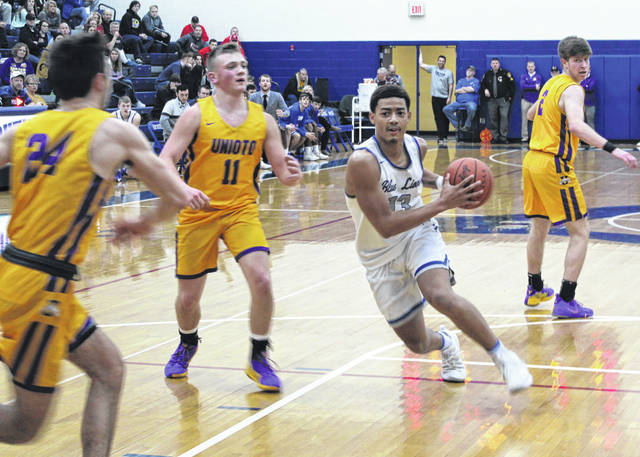 Washington senior Omar Porter drives the lane against Unioto in a Division II Sectional championship game Friday, Feb. 22, 2019 at Southeastern High School. Pictured for the Shermans are (l-r); junior Cade McKee, sophomore Isaac Little and sophomore Cameron Debord.