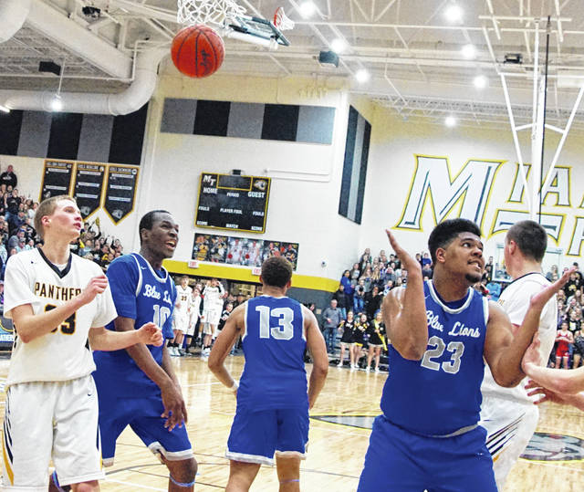 Washington Blue Lion senior Richie Burns, at right (No. 23) reacts as his game-winning shot falls through the net at Miami Trace High School Saturday, Feb. 9, 2019. Also pictured (l-r); Austin Brown of Miami Trace, Blaise Tayese and Omar Porter of Washington and Dylan Bernard of Miami Trace.