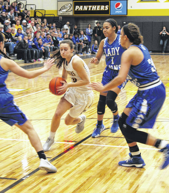 Miami Trace junior Shay McDonald drives to the basket while guarded by (l-r); Washington senior Kassidy Hines, junior Rayana Burns and senior Hannah Haithcock during a Frontier Athletic Conference rivalry game at the new Miami Trace High School Saturday, Feb. 9, 2019.