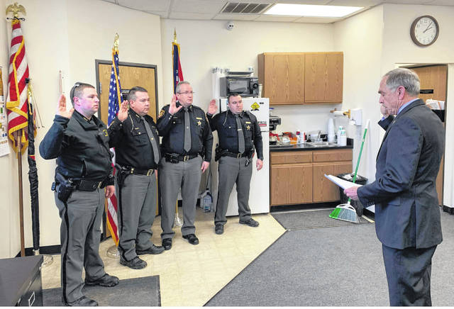 Peter Tobin, the U.S. Marshal for the southern district, swears in Fayette County Sheriff's Office deputies as special deputy U.S. marshals on Wednesday: deputy Andy Parks, Sgt. Chuck Kyle, chief deputy Andy Bivens and deputy Howard Wood.