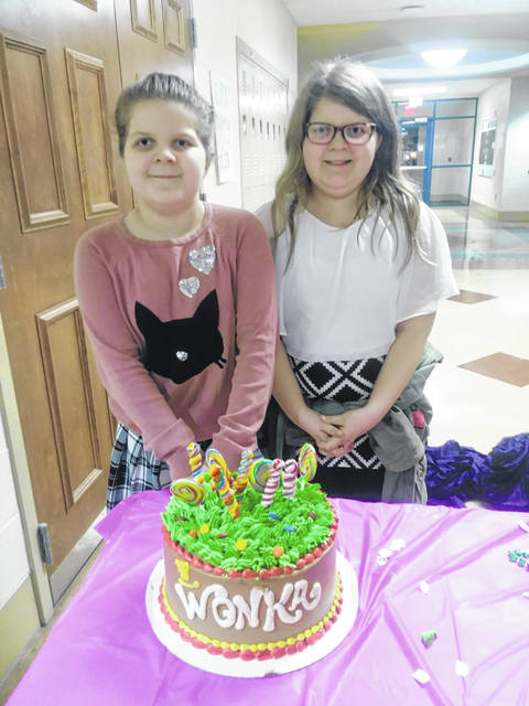 Belle Aire Intermediate held Literacy Night at the Washington Middle School on Thursday. Pictured is Liliana (left) and Alivia (right) Dawson. These twins won the raffle for a Willy Wonka cake courtesy of Carnegie Public Library. The cake was made by Country Cakes and Bakes located in New Holland. See more photos of the event inside.