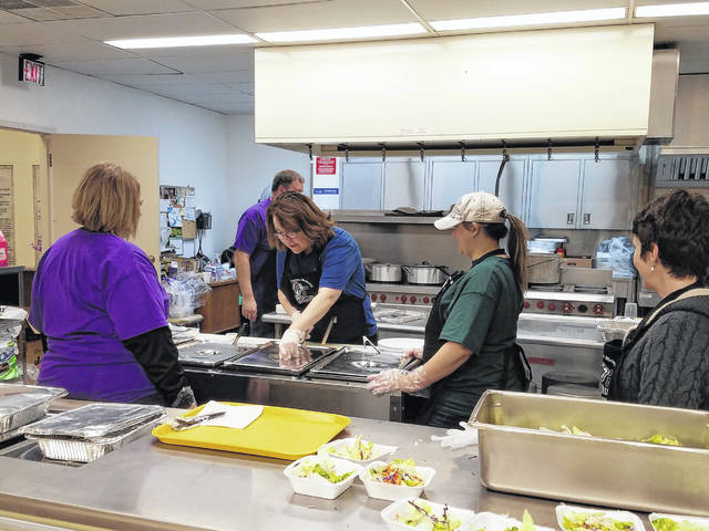 Volunteers prepared a delicious meal for the many patrons.