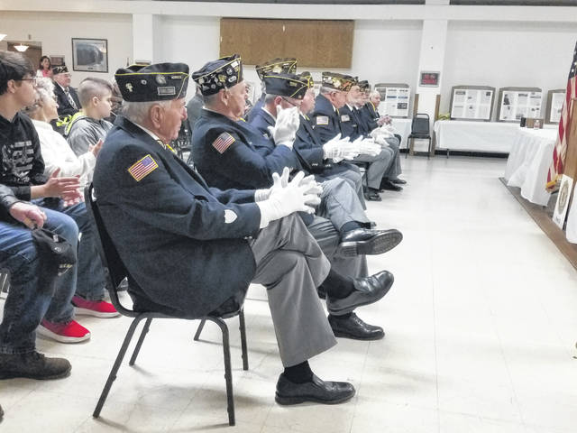 Members of the Fayette County Honor Guard presented colors on Saturday evening and enjoyed LaRue's story of Paul Hughey.