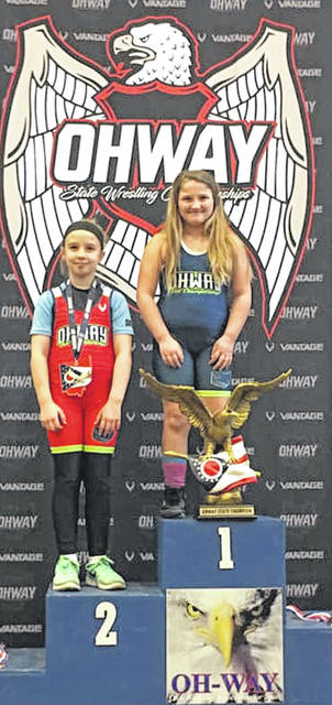 Haleigh McGraw stands at the top of the podium after winning the OHWAY 8U 59lb+ State Championship. She won both of her matches by pin. Haleigh is a second-grader at Miami Trace.