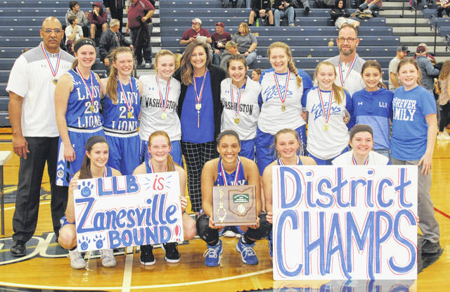 2019 DISTRICT CHAMPION WASHINGTON LADY BLUE LIONS — The team on the court at Southeastern High School after an exciting 47-45 win over Vinton County Wednesday, Feb. 27, 2019. It is the second District title in the program's history, the first coming in 1991. (front, l-r); Kassidy Hines, Tabby Woods, Hannah Haithcock, Bre Taylor, Maddy Jenkins; (back, l-r); assistant coach Mychal Turner, Shawna Conger, Halli Wall, Abby Tackage, head coach Samantha Leach, Aaralyne Estep, Haven McGraw, Arianna Heath, assistant coach Corey Dye, Leah Marine and Karris Dye. Not pictured: Rayana Burns.