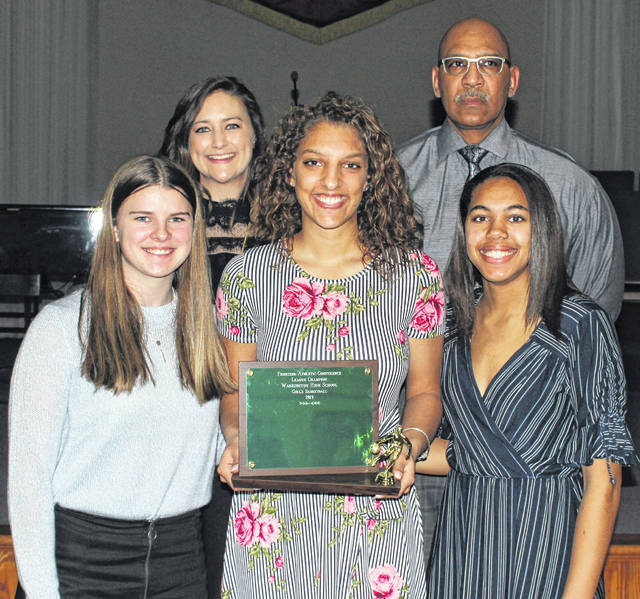 The Washington Lady Blue Lions received their FAC championship trophy for basketball at the winter sports banquet Thursday, March 14, 2019. (front, l-r); Shawna Conger, Hannah Haithcock, Rayana Burns (back, l-r); head coach Samantha Leach and assistant coach Mychal Turner.