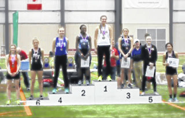 Macy Creamer stands in the sixth spot (second from left) on the State indoor track podium for the triple jump Saturday, March 2, 2019 at Geneva, Ohio.