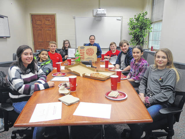 "Donatos recently provided pizza to these students at Washington Middle School as they celebrated ""Pizza with the Principals."" This is in appreciation for their selection as Students of the Month for March. They are chosen by their teachers because of the outstanding example they set for their peers in such areas as academic effort, good work ethic, kindness to others, and service to their school. Pictured (L to R): Sofia Sisco, Ian Fleming, Connor Day, Jenika Bowling, Mr. Wayne, (Principal) Isaiah Smith, Saul Haynes, Jillian Frederick and Tadem Wright."