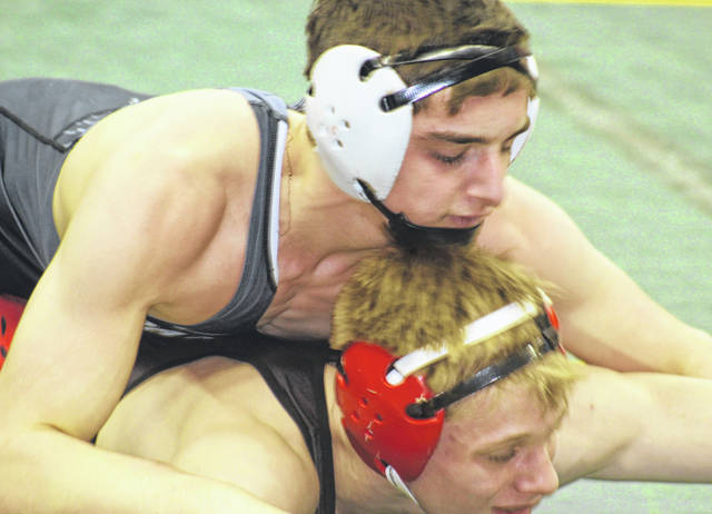 Miami Trace sophomore Mcale Callahan wrestles his third match at State on Day Two in the consolation second round against Jacson Muldrew of Stuebenville Friday afternoon, March 8, 2019.