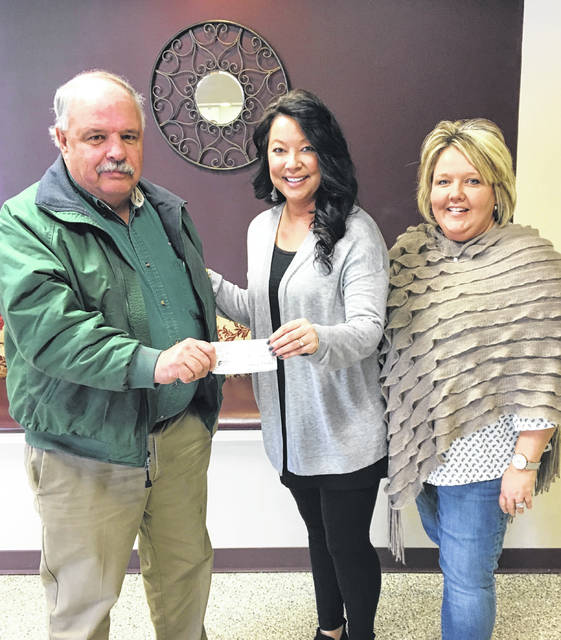 Ron Weade of the Good Hope Lions Club made a $1,000 donation to the Fayette County Meals on Wheels program. Pictured are Weade, Ginger Munro, assistant director of senior nutrition, and Lori Bach, assistant director of the Fayette County Commission on Aging.