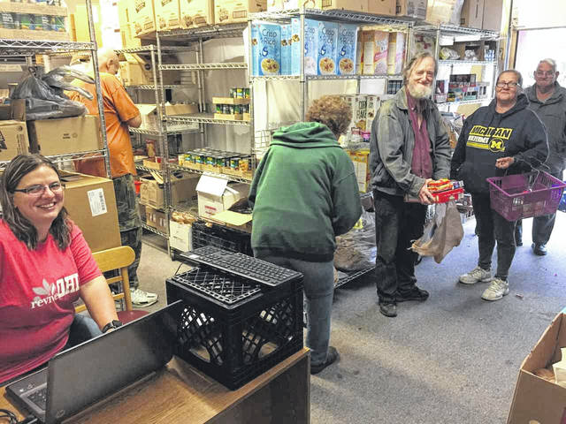 Neighbors and volunteers at The Well's pantry.