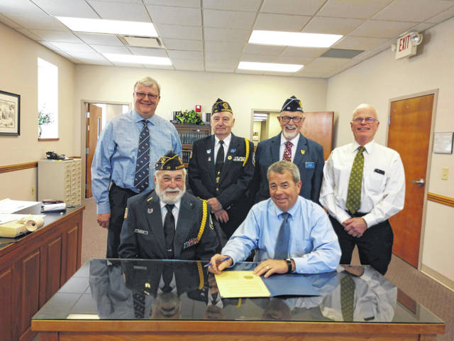 Members of the American Legion Post 25 joined the Fayette County Commissioners as the commissioners signed a proclamation. The proclamation detailed portions of history for the Paul H. Hughey American Legion Post and commended the post for its 100 years of service to veterans, and encouraged the community to also commend the post. Pictured (L to R): Fayette County Commissioner Dan Dean, American Legion Post 25 and Fayette County Honor Guard member Glenn Rankin, American Legion Post 25 and Fayette County Honor Guard member Dave Frederick, Fayette County Commissioner Tony Anderson, American Legion Post 25 and Fayette County Honor Guard member Paul Sands and Fayette County Commissioner Jim Garland.