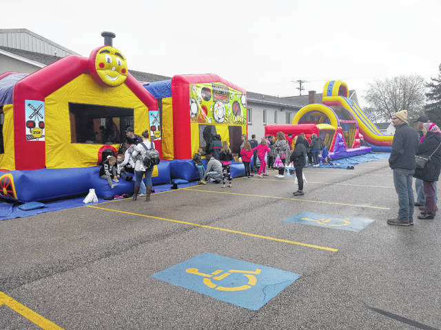 South Side Church of Christ held an Easter egg hunt on Saturday, April 20. In addition to the hunt, they had several inflatables outside for children to enjoy as parents and guardians kept an eye on them. The weather was a little chilly with rain. The adults were huddling in their coats enjoying the sight of their kids and grandkids having a nice and active time.