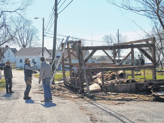 "On Monday, employees of ""The Barn & Cabin Friend"" could be seen behind Morrow Funeral Home in Jeffersonville removing an old barn. The barn is owned by Dale and Penny Palmer — of Jeffersonville — who said Dale's father played in the barn when he was a kid over 80 years ago. The couple said they believe it was built before the turn of the 20th century, making it well over 100 years old. A representative of The Barn & Cabin Friend on-site said the structure is not being demolished, but rather the wood will be moved to another location to be repaired before they rebuild the barn."