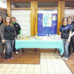 Merchants holds bake sale for local charities