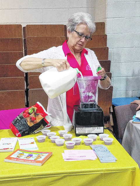 The Community Health Fair and Family Fun Day was held Saturday at Grace Community Church with a large crowd joining for the various attractions throughout the day. Jeannie Bihl — with Fayette County Public Health — was busy making smoothie samples to hand out to the crowd along with the recipe.