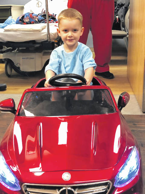 Adena pediatric surgery patient Cooper is ready to ride in style on his way to the operating room.