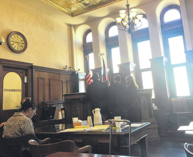 Defendant Tova Wallace-Lee looks down as Assistant prosecutors David Hayes and Charles Morrison, and Defense Attorney Kirsten Knight approach Judge Michael A. Buckwalter during trial April 22.