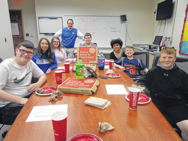 "Donatos recently provided pizza to these students at Washington Middle School as they celebrated ""Pizza with the Principals."" This is in appreciation for their selection as Students of the Month for April. They are chosen by their teachers because of the outstanding example they set for their peers in such areas as academic effort, good work ethic, kindness to others, and service to their school. Pictured from left: Matthew Zickafoose, Madison Haithcock, Alyssa Persinger, Mr. Wayne, Principal, Landen Mayfield, Jaelynn McCullough, Gavin Coffman and Bevin Wilson. Jhara Larson was absent from picture."