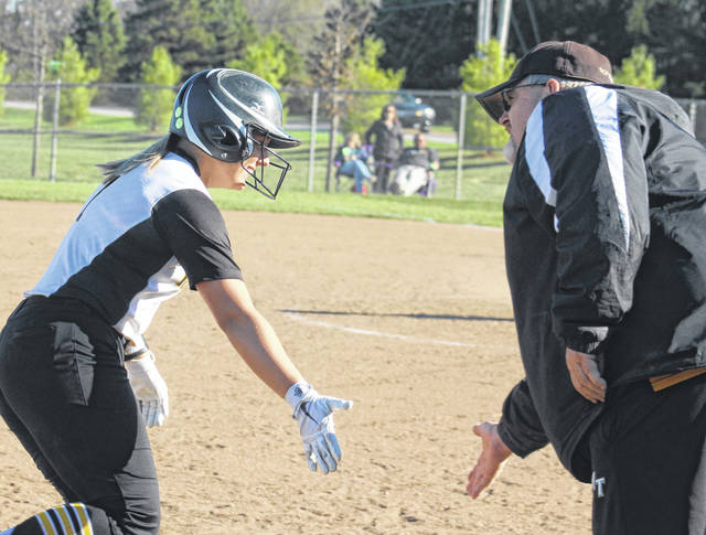 Ashley Campbell, left, receives congratulations from head coach Joe Henry after hitting her second home run of the game in the fourth inning against East Clinton Tuesday, April 9, 2019. Campbell now has six home runs on the season.