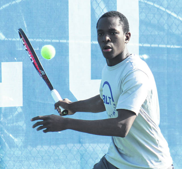 Washington's Blaise Tayese keeps his eyes on the ball preparing for a return during a second singles match against Greeneview Monday, April 1, 2019 at Gardner Park.