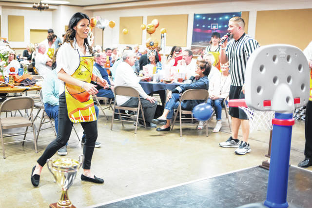 The Fayette County Family YMCA held the eighth-annual Celebrity Waiter Dinner Saturday. The fundraising dinner helps to fund YMCA program and raised $33,000 this year. Celebrity waiter Chelsie Baker participated in many ways during the event, including playing a basketball-themed game.