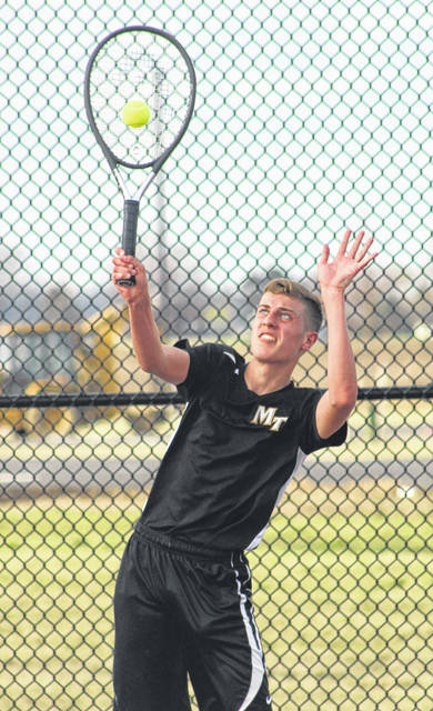 Miami Trace's Devin Riggs serves during his second singles match against Jackson Monday, April 8, 2019 at Miami Trace High School.