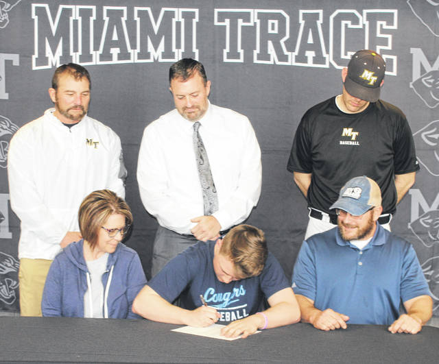 Miami Trace senior Drew Batson, center, recently signed a letter of intent to attend Mount Vernon Nazarene University where he will study nursing and continue his athletic career as a member of the Cougars baseball team. Batson is flanked by his parents, Bethany and David and is joined by (standing, l-r); Miami Trace head baseball coach Rob Smith, Miami Trace Superintendent David Lewis and assistant baseball coach for the Panthers, Matt Platt.