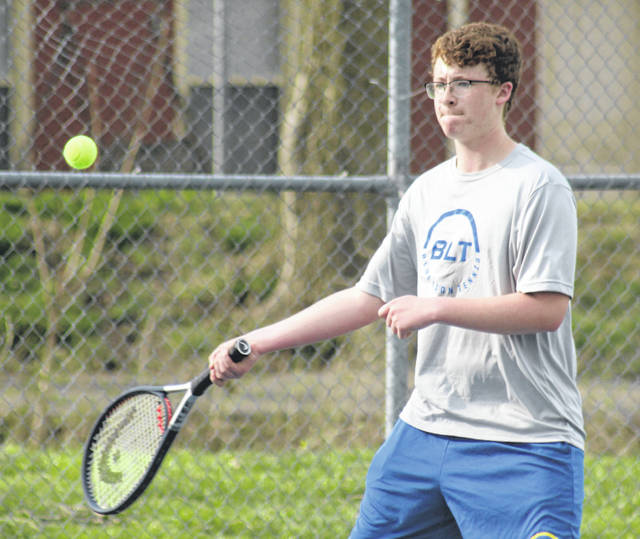 Washington's Garrett DeWees makes the return during a first doubles match, along with partner Ty Rose, against Hillsboro Monday, April 8, 2019 at Gardner Park.