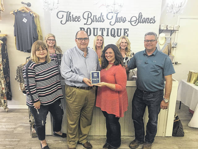 The Three Birds Two Stones Boutique held its grand opening last week. Pictured are various city representatives with the owner Brittany Pfeifer.