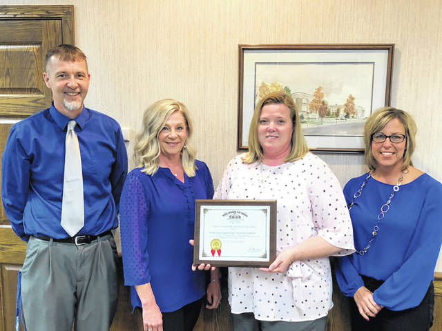 The Washington Court House City Schools recently received a returned clean audit report from the Auditor of State's office and earned an Auditor of State Award. Pictured (L to R): Buckie Caulley, Accounts Payable Coordinator; Cheri Shipley, Accounts Receivable/Secretary to the Treasurer; Becky Mullins, Treasurer/CFO; and Erica Malone, Assistant Treasurer.