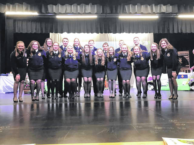 2018-2019 retiring officers are pictured with the 2018-2019 Ohio State FFA officers: Bottom Row Left to Right- State Treasurer-Kalyn Strahley, Chapter Treasurer-Cassie Baird, Chapter President-Meri Grace Carson, Chapter Vice President-Abbi Pettit, Chapter Treasurer-Morgan Eggleton, Chapter Student Advisor-Anita Pursell, State Vice President at Large-Emma Dearth, Chapter Building Communities-Lahni Stachler, Chapter Reporter-Aubrey Schwartz, Chapter Publicity Reporter-Aubrey McCoy, State Sentinel-Mallary Caudill. Top Row Left to Right- State Vice President-Holly McClay, State President-Kolesen McCoy, Chapter Secretary-Andrea Robinson, Chapter Land Lab Manager- Luke Anders, Chapter Strengthening Agriculture- Wyatt Atley, Chapter Growing Leaders-Graham Carson, State Vice President at Large-Tyler Zimpfer.