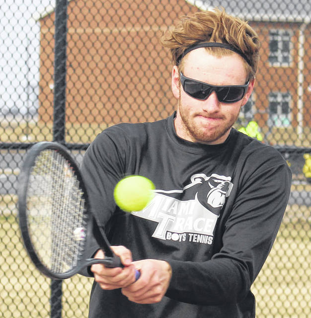 Miami Trace's Isaac Abare makes the return during his first singles match against Chillicothe Thursday, April 4, 2019 at Miami Trace High School.