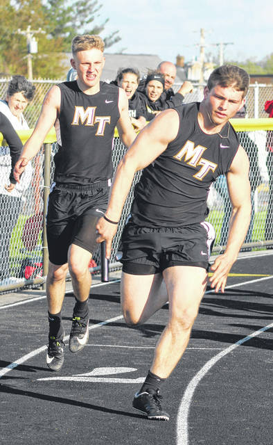 Josh Liff takes off with the baton after the exchange with Jake Atwood during the 4 x 100-meter relay for Miami Trace at the McClain Bob Bergstrom Invitational Friday, April 26, 2019 in Greenfield.