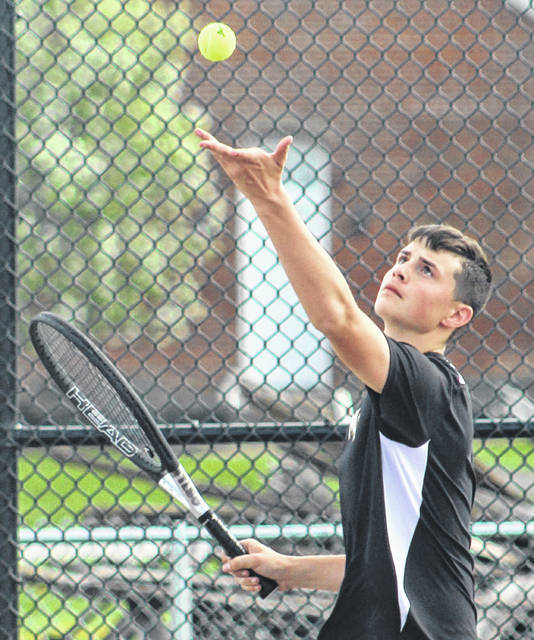 Rylan Gardner serves for Miami Trace during a first doubles match against Unioto Tuesday, April 23, 2019 at Miami Trace High School.