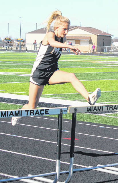 Miami Trace's Macy Creamer clears a hurdle on her way to winning the 100-meter event during a tri-meet at Miami Trace High School Tuesday, April 9, 2019.