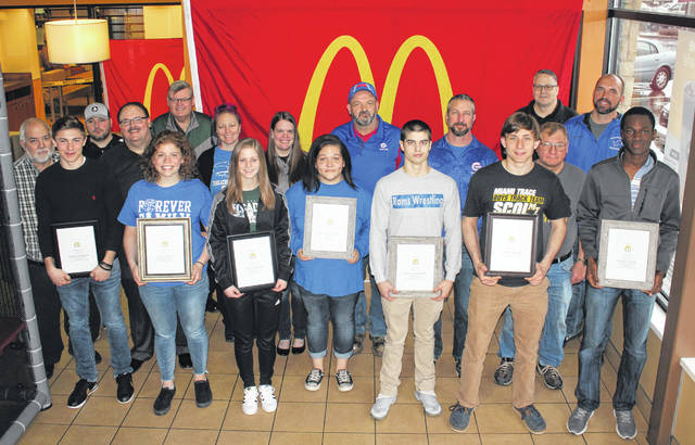 McDonald's of Fayette County and Jamestown on Saturday recognized nine student-athletes for the 2018-19 winter sports season. The student-athletes were interviewed by Randy Young for a live Facebook program and were served breakfast. (front, l-r); Nicholas Epifano, Fayette Christian School, basketball; Julie Bailey, Washington High School, swimming; Taylor Brown, Fayette Christian School, basketball; Anna Williamson, Greeneview High School, bowling; Devan Hendricks, Greeneview High School, wrestling; Andrew Amore, Miami Trace High School, bowling; Blaise Tayese, Washington High School, basketball; (back, l-r); Randy Young, commentator and interviewer for the Facebook broadcast; Ben Ackley, Miami Trace High School girls basketball coach; Nick Epifano, owner and operator of McDonald's of Fayette County and Jamestown; Larry Fitch, Fayette Christian School principal; Katie Kasberg, Washington High School swim coach; Angela Harris, Fayette Christian School girls basketball coach; Dave DeBord, Greeneview High School bowling coach; Mark Matt, Greeneview High School wrestling coach; Ron Amore Sr., Miami Trace High School boys bowling coach; Aaron Hammond, Miami Trace High School Athletic Director and Mark Bihl, Washington High School Athletic Director. There are pictures of Washington High School's Hannah Haithcock and coach Samantha Leach, basketball and Miami Trace High School's Olivia Wolffe and Ben Ackley, basketball, in today's sports. Not pictured: Gary Shaffer, Fayette Christian School boys basketball coach and Connor Scott, Washington High School boys basketball coach.