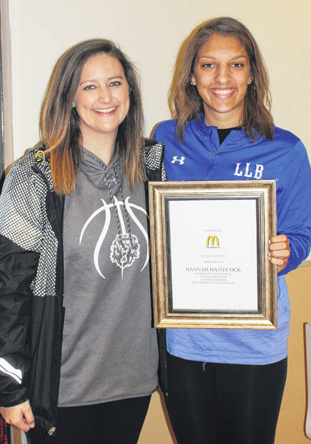 Washington High School's Hannah Haithcock, right, was the co-female winter sports student-athlete, recognized by McDonald's of Fayette County and Jamestown Saturday, March 30, 2019. She was joined for the occasion by Washington's girls basketball coach, Samantha Leach.
