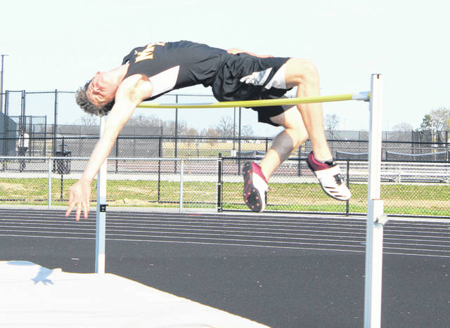Wyatt Cory competes in the high jump for Miami Trace Tuesday, April 16, 2019. Cory placed second in this event and also won the 200-meter dash and pole vault events.