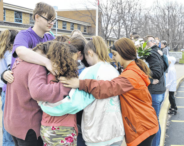 Classmates and others come together Wednesday evening outside the Wilmington Middle School at a prayer vigil for Alaina Quillin. For more photos, visit wnewsj.com.