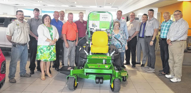 The FCMH Foundation is holding a raffle fundraiser for this John Deere zero-turn mower. Pictured from left are front row: Whitney Gentry, FCMH Foundation, Jennie Merriweather, Gusweiler office manager; back row: Andy Swisshelm representing Ag-Pro, Brooks Pursley, Danny McKnight and Dave Pence of Gusweiler Toyota, Curt Curtis, Keith Burns and Rick Fagan, Gusweiler GM, Mike Diener, FCMH CEO, Stephen Farrens, Vermeer Heartland, Roger Kirkpatrick and Ron Ratliff, FCMH Foundation.