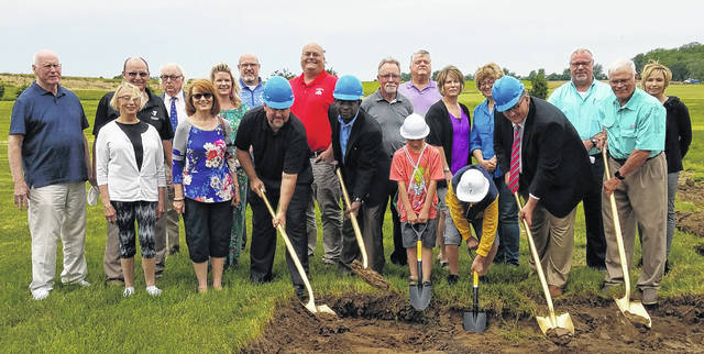 City Manager, Joe Denen, and County Commissioner, Jim Garland, are joined by two YMCA Day Camp participants and YMCA board members for the groundbreaking for an expansion of the facility on Civic Drive on Wednesday.