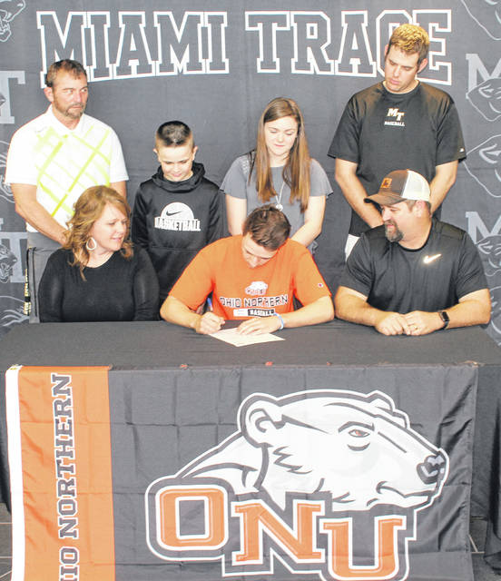 Miami Trace senior Austin Mathews, seated, center, signs a letter of intent to attend Ohio Northern University. He is flanked by his parents, Tammy and Joe Mathews. Standing (l-r); Miami Trace head baseball coach Rob Smith, Austin's brother and sister, Ben and Kandice and assistant baseball coach Matt Platt.